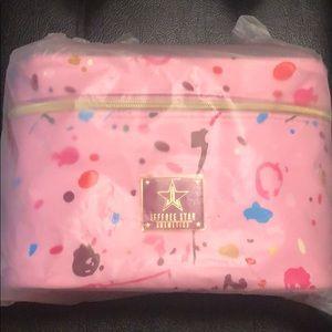 JS pink travel makeup bag